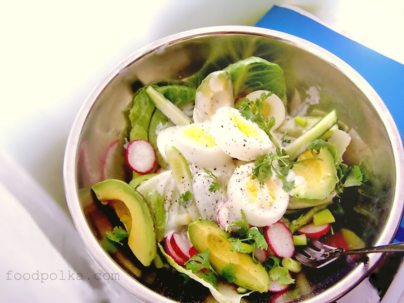 Garden salad with avocado and wasabi dressing